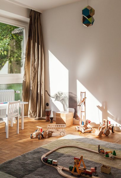 The feel of natural materials on the skin can make a home comforting. A Colour Carpet by Scholten & Baijings for HAY, made with 100% New Zealand wool, defines the play area in the child's bedroom of this house in Hamburg, Germany.