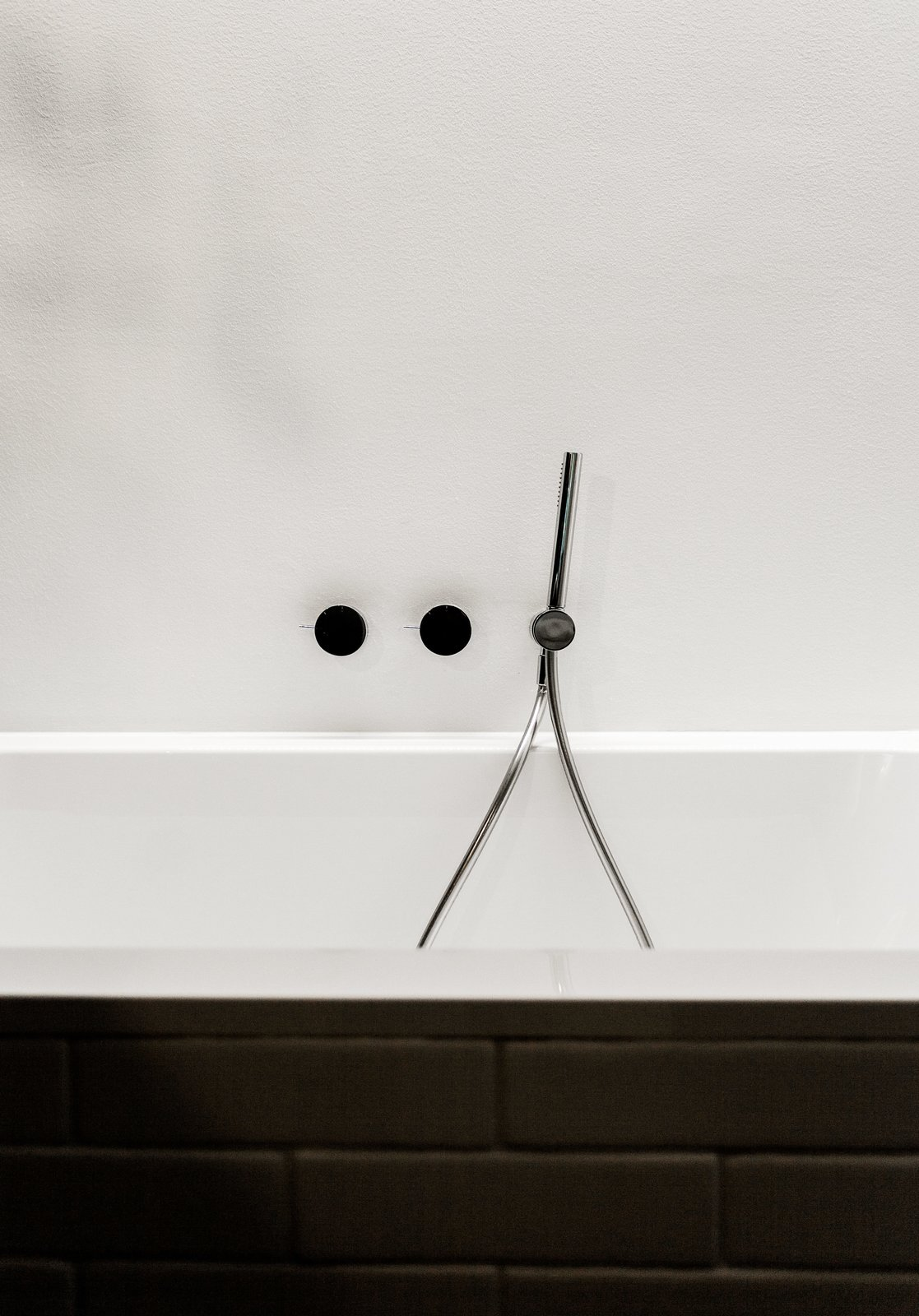 Bath Room and Alcove Tub Fixtures by Naoto Fukasawa for Aboutwater, a collaboration between Boffi and Fantini, adorn the Villeroy & Boch tub.  Photo 9 of 12 in We Can't Get Enough of This German Apartment's Sleek Matte-Black Kitchen