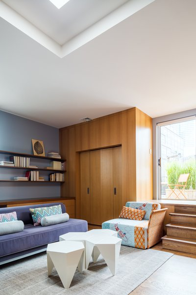 The master bedroom has a sitting area with a Twilight sofa from Design Within Reach and Noguchi's Prismatic tables from Vitra. The pillows are upholstered with Missoni's Kew fabric.