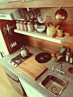 Herbert fashioned the custom kitchen countertop from a foam-core backer board, which he coated with a concrete microtopping. The wood is clear-grain cedar.