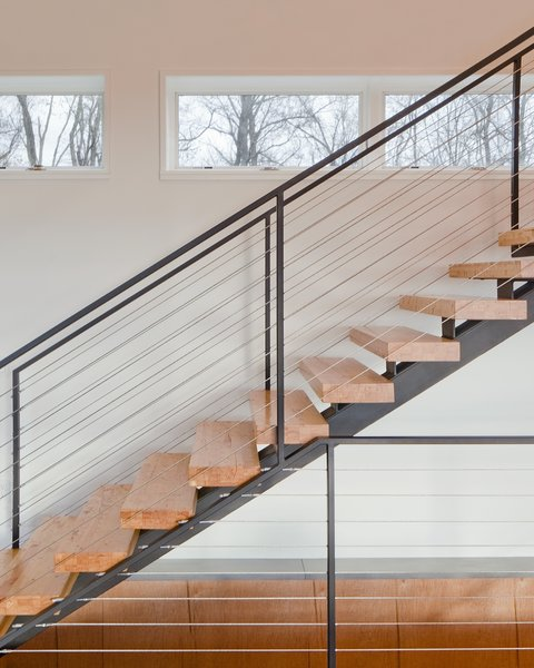"""""""The clients desired a maintenance-free, year-round home using the ultimate in 'green' building methodologies,"""" Mulvena says. The staircase is an example of the construction's mindset: it is made from the leftover laminated veneer lumber used on the roof."""
