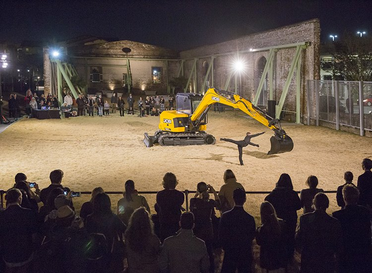 The Beau Geste dance troupe performs Exceptional Transport: duet for a dancer and an excavator.  A building tool is transformed into a dangerous partner for a pas de deux in a performance by French dance troupe Beau Geste.  Photo 3 of 8 in When Art and Architecture Meet, the Results Can Be Wild
