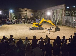 The Beau Geste dance troupe performs Exceptional Transport: duet for a dancer and an excavator.  A building tool is transformed into a dangerous partner for a pas de deux in a performance by French dance troupe Beau Geste.