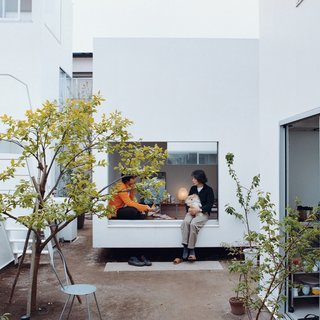 In a tightly packed Tokyo, a group of apartments shares a central courtyard. Photo by Dean Kaufman.