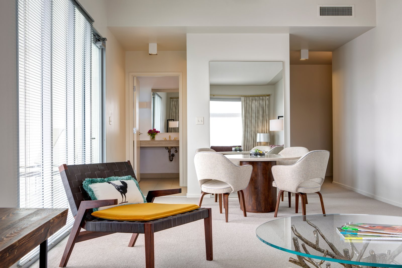 Dining Room, Table, Carpet Floor, Ceiling Lighting, and Chair 104 rooms with six room types are designed by Deborah Berke Partners with a residential feel.  Photo 7 of 9 in Head to Arkansas for What May Be America's Coolest Art and Design Hotel