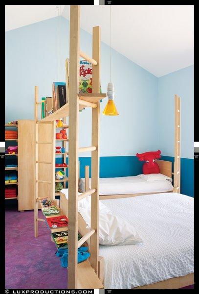 The children's rooms, which are reserved for family and an extended network of friends, feature more custom Crasset-designed beds set against a vivid blue backdrop, courtesy of the French paint brand Zolpan.