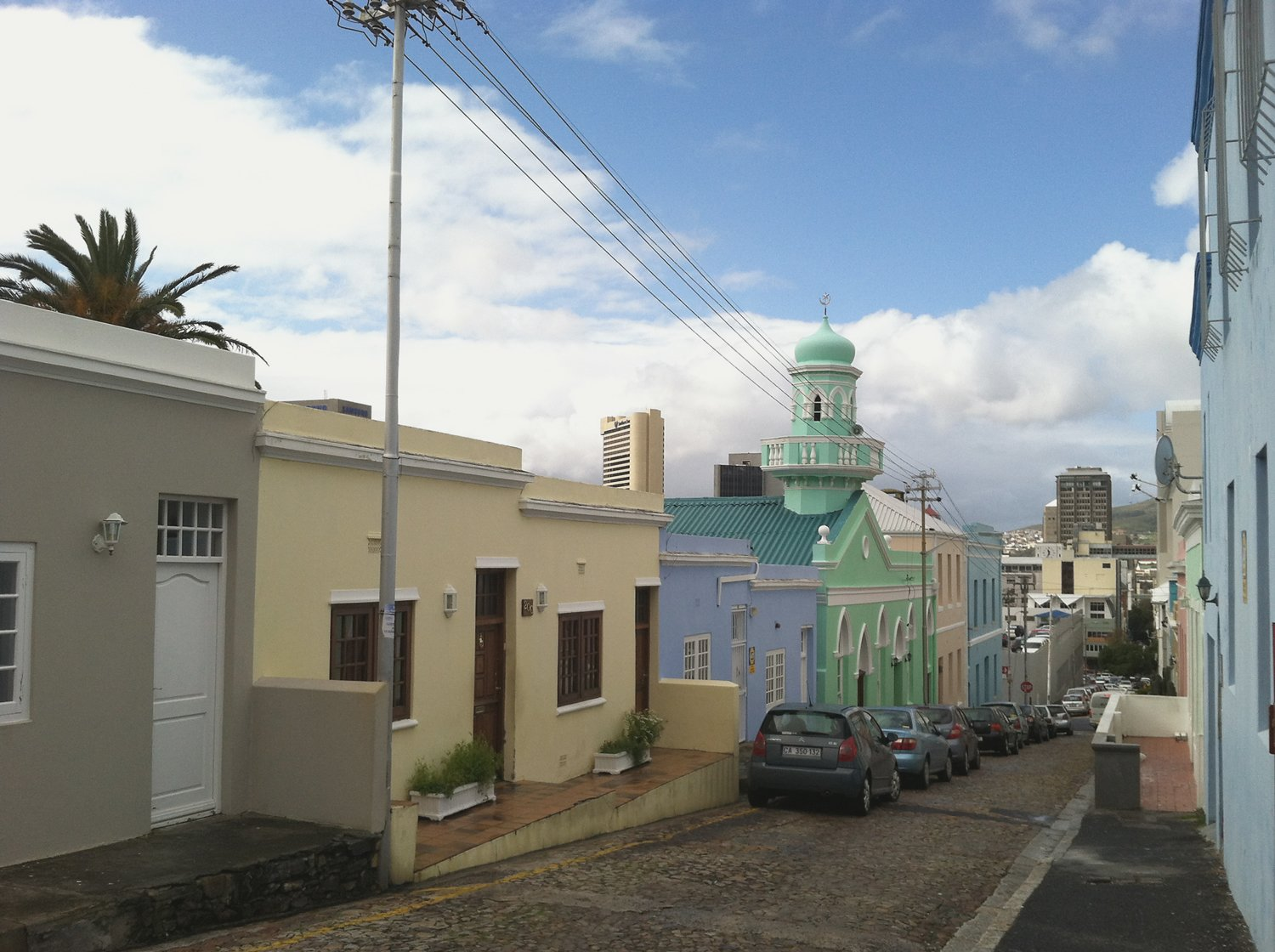 "Bo Kaap  Known as the ""Upper City"", or the Malay Quarter, this colorful series of streets has historically been home to Cape Town's Muslim population and cape Malay culture. Here, visitors can stop by local spice markets, take a scenic walk, and generally experience one of the city's most celebrated historic areas. Photo by Laura Feinstein.  Photo 1 of 13 in Design Travel Guide: Cape Town, South Africa"