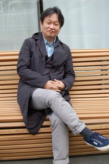 Naoto Fukasawa takes his turn posing on his Titikaka bench, which features undulating teak slats and an aluminum frame. In conversation with Sam Grawe, the designer said the sinuous form, as well as the name, was inspired by the traditional straw boats of Peru and Bolivia.