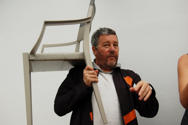Starck demonstrates the lightweight heft of his new outdoor chairs for Dedon. Look for Sam's interview with him soon.