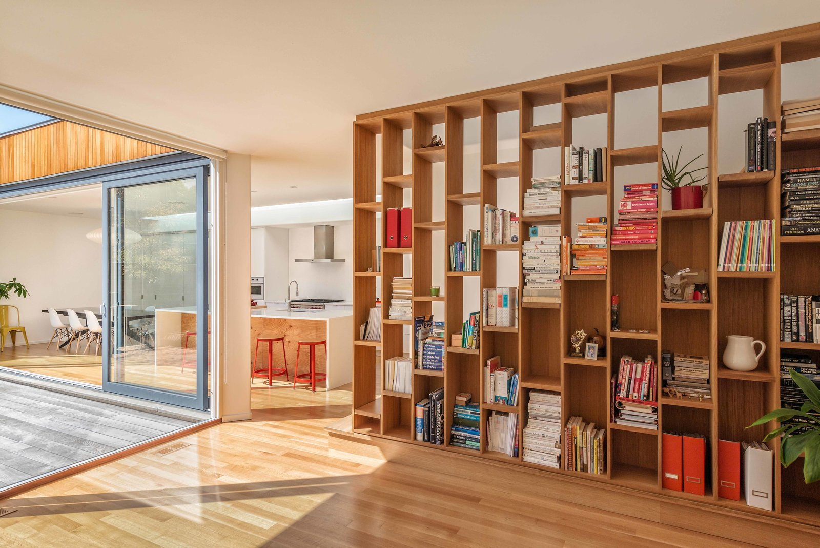 Adaptability is integral to supporting residents of various ages. Intelligent features, like millwork that can be removed to change the communal spaces' configurations, will enable the home to evolve with its occupants.  Photo 5 of 5 in One Big Idea for Driving Down Rocketing Housing Costs