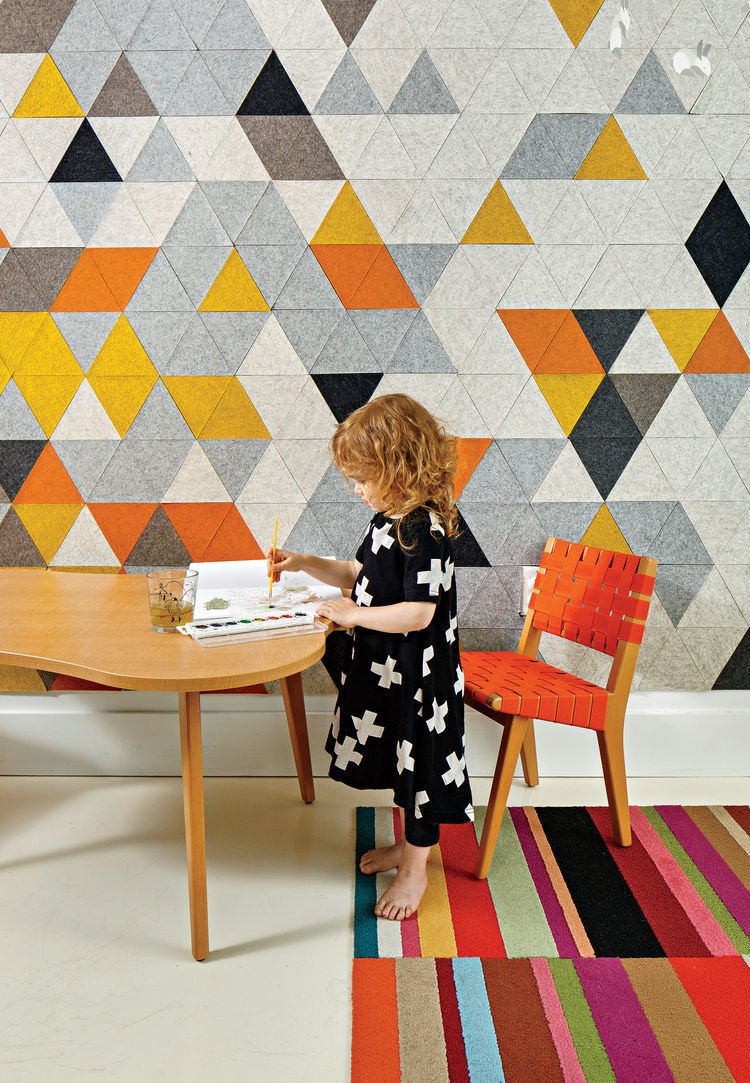 Risom has long graced the pages of Dwell—it's hard to miss his classic modern designs. In this Boston family residence, a custom prototype mural by FilzFelt and a carpet by Flor join a child-size chair and Amoeba table that Risom designed for Knoll.  Photo 5 of 9 in Happy 100th Birthday, Jens Risom