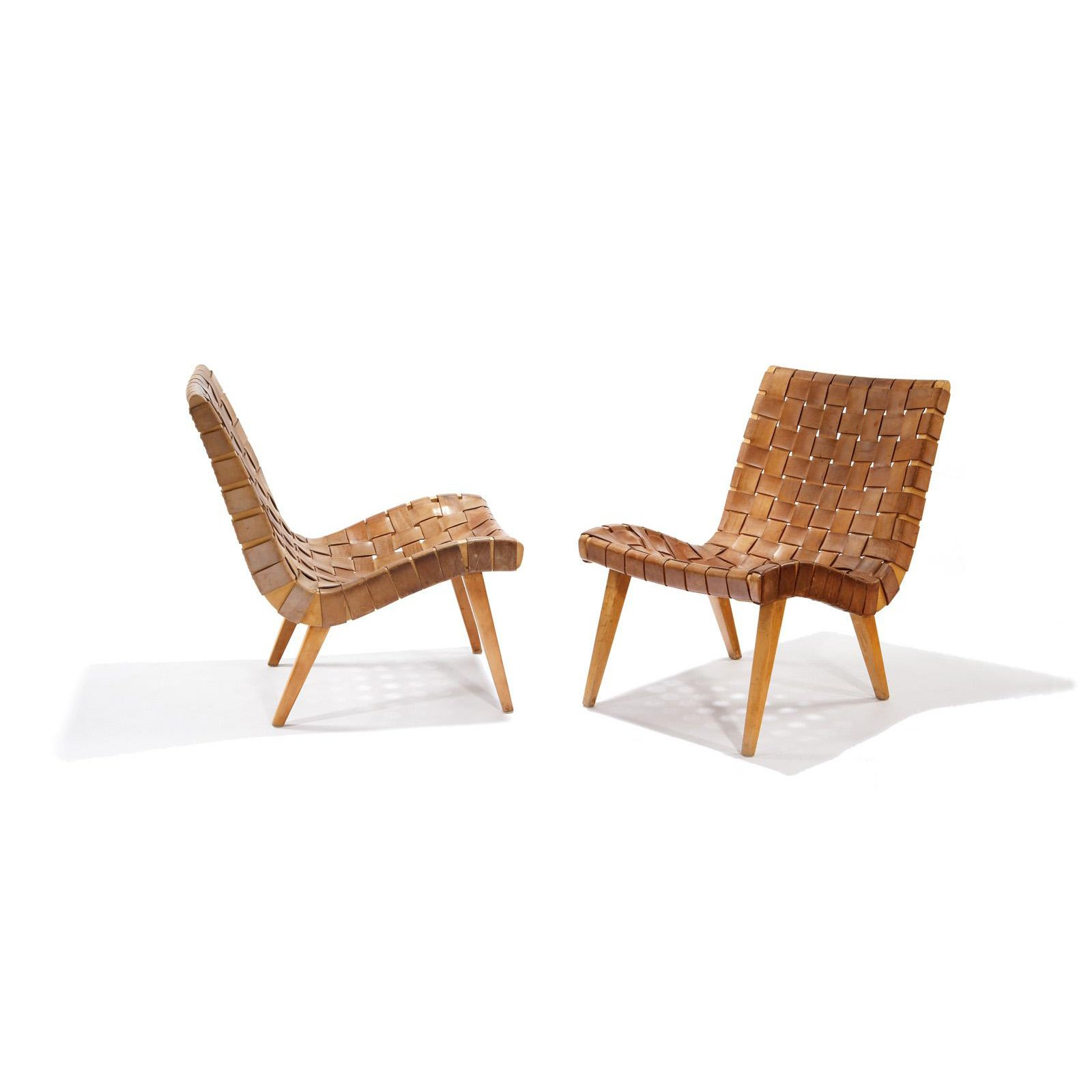 Shortly after his arrival to the United States in 1939, Risom met Hans Knoll, the founder of Knoll, with whom he would work to produce some of the company's earliest interior and furniture designs. Widely known as the first chair to be designed for Knoll, this iconic Risom Lounge Chair brought the natural materials and understated form of Scandinavian design to large-scale U.S. production. It makes use of few materials that were widely available during wartime—surplus army webbing and parachute straps—wrapped around a supple, curving wooden frame.  Photo 4 of 9 in Happy 100th Birthday, Jens Risom
