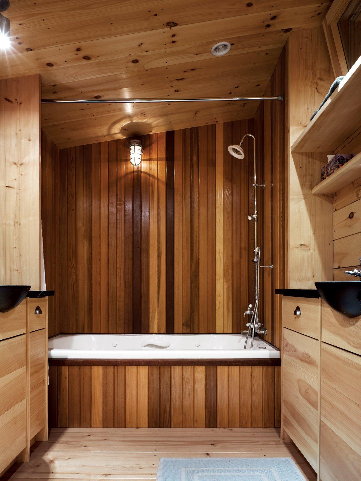 #bath #spa #bath&spa #modern #interior #interiordesign #bathroom #shower #bath #woodpanels #masterbath #twinsinks #maine #penobscotbay #storage   Photo by Raimund Koch  Photo 9 of 22 in Bath & Spa Intrigue from Bath