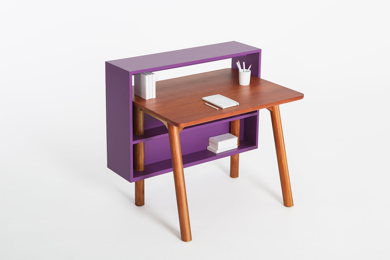 The PLAYplay collection by Lanzabecchia + Wai for Journey East features the Bazaar desk, a compact writing surface with built-in shelves that can be accessed from both sides of the piece.  Photo 2 of 9 in New Products to Solve Your Tiny Apartment Woes