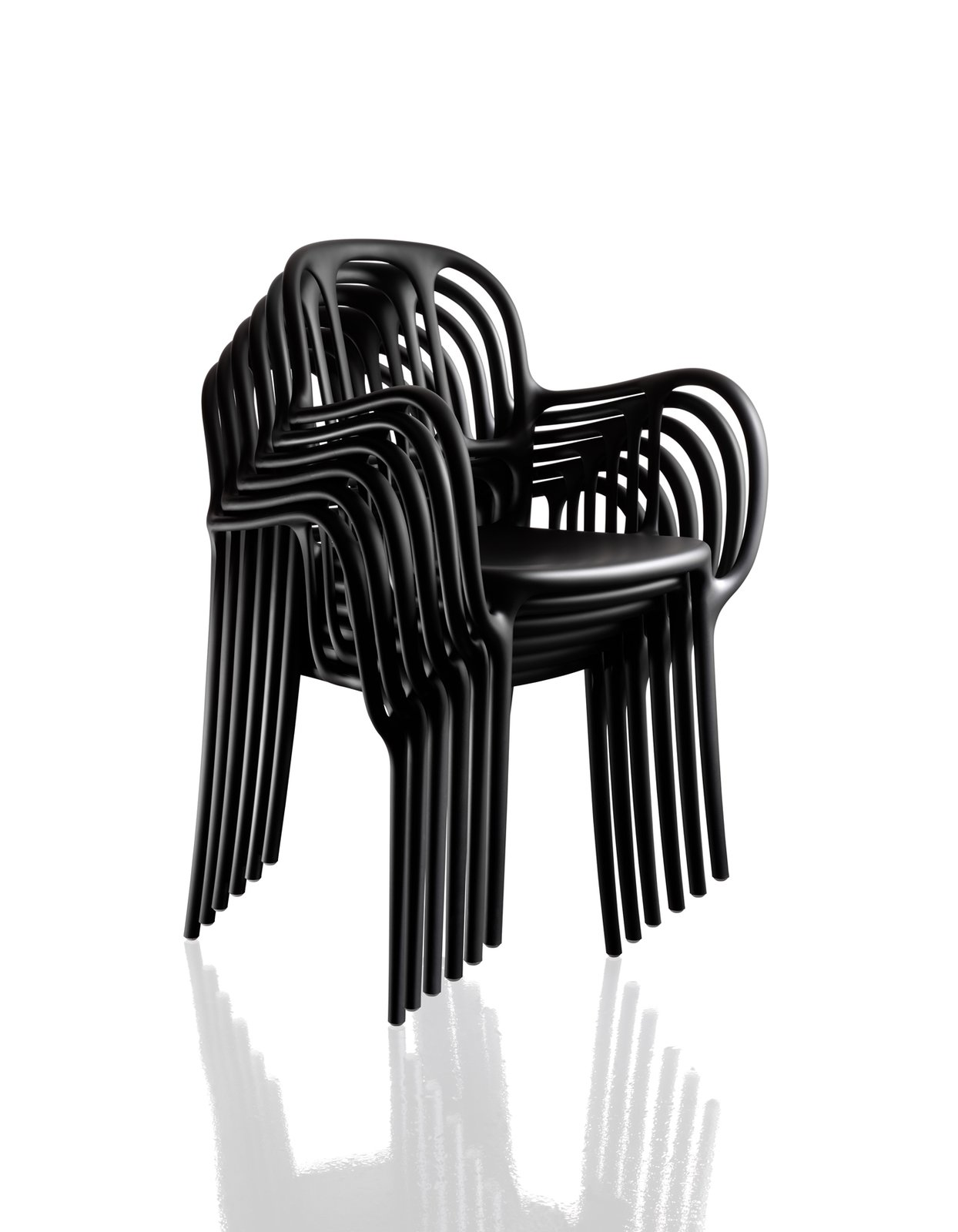 Stash a stack of Milà chairs in the hall closet for extra seating. Jaime Haydn's design for Magis, made of plastic, achieves its sculptural form through gas-injection molding.  Photo 7 of 9 in New Products to Solve Your Tiny Apartment Woes
