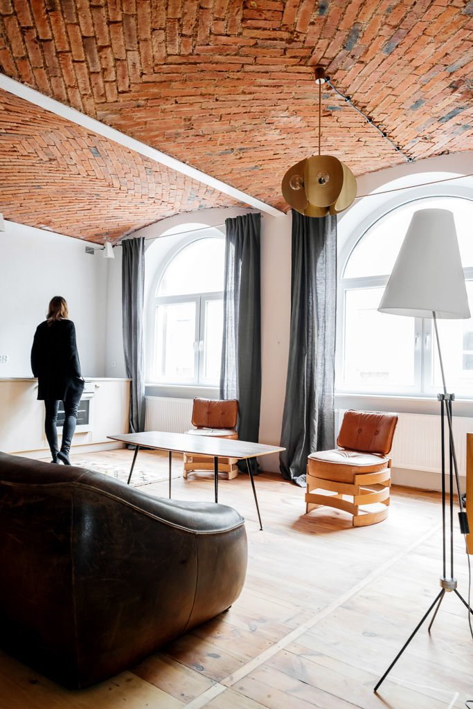 By burnishing historic details and adjusting the floor plan, multidisciplinary studio Loft Szczecin restored and transformed a loft in a warehouse that dates from before World War II. The living room rug is a Polish textile from the 1930s. Most of the furniture is vintage from Denmark, the Czech Republic, Poland, and the Netherlands.  20+ Modern Warehouse and Garages Conversions by Zachary Edelson from All This Warehouse Stores Nowadays Is Impeccably Cool Furniture