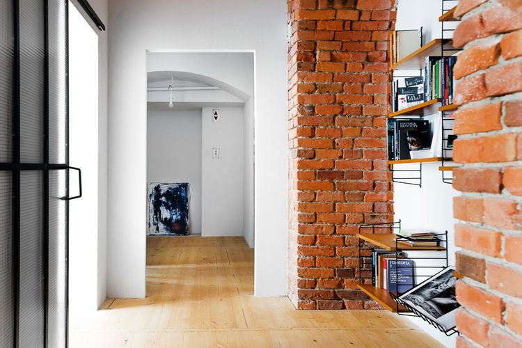 In addition to reconstructing an open living room, Loft Szczecin had to subdivide four smaller spaces to create privacy in the expansive warehouse.  Photo 3 of 5 in All This Warehouse Stores Nowadays Is Impeccably Cool Furniture