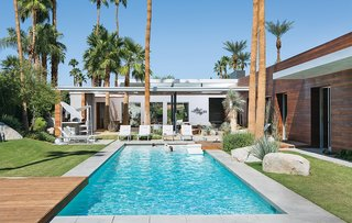 Architect Sean Lockyer designed a 5,760-square-foot concrete, stucco, and ipe home for a couple and their three children in the Southern California desert town of Indian Wells. The residents selected the home's furnishings, including the Royal Botania chaise lounges.
