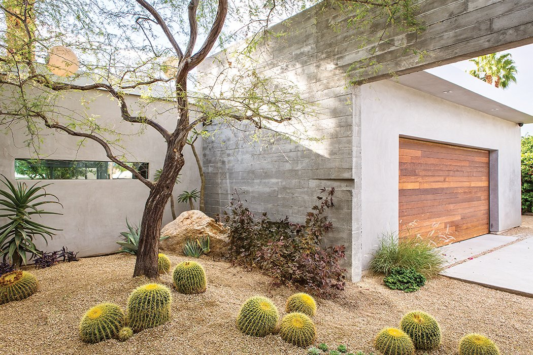 Outdoor and Desert Lockyer added native desert plans to a courtyard near the garage.  Photo 4 of 13 in One Canadian Family Beats the Cold by Escaping to Palm Springs