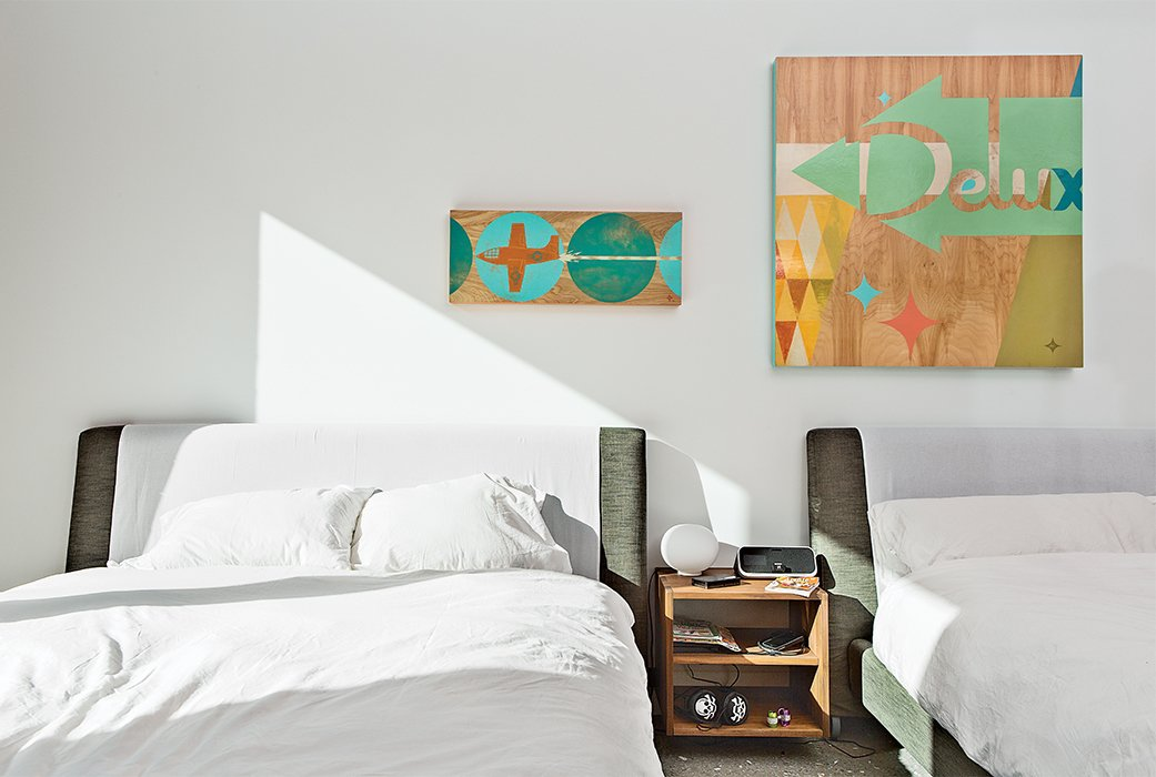 Bedroom, Bed, and Night Stands The children's bedroom, which is located next to the playroom, has beds from Bensen and artworks by Aaron Eskridge from Just Modern.  Photo 9 of 13 in One Canadian Family Beats the Cold by Escaping to Palm Springs