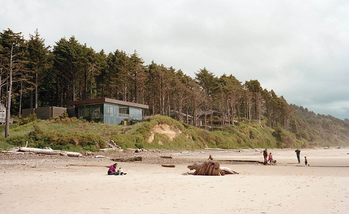 Boora Architects designed a house for Ryan and Mary Finley near Cannon Beach, Oregon, that resembles a glass prism and rises above a shallow cliff overlooking the Pacific Ocean. The 3,330-square-foot structure is topped with a green roof.  Photo 45 of 51 in 50 Jaw-Dropping Glass Houses That Shatter Expectations from Beach