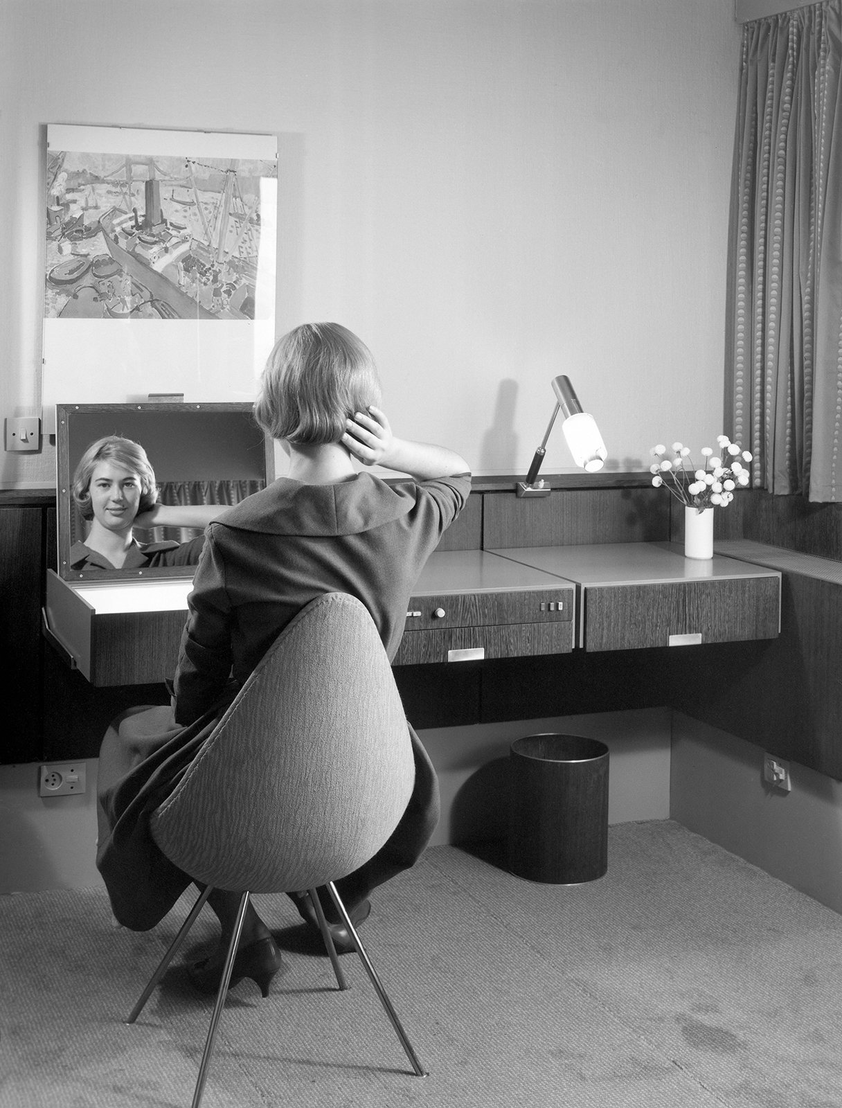 Arne Jacobsen designed nearly every element of the hotel, including the built-ins, textiles, and accessories. In addition to furnishing the rooms with existing pieces from his portfolio, Jacobsen created new pieces for the hotel, like the Drop chair shown in this archival photo.  Photo 4 of 10 in Jaime Hayon is Given the Keys to an Iconic Copenhagen Hotel