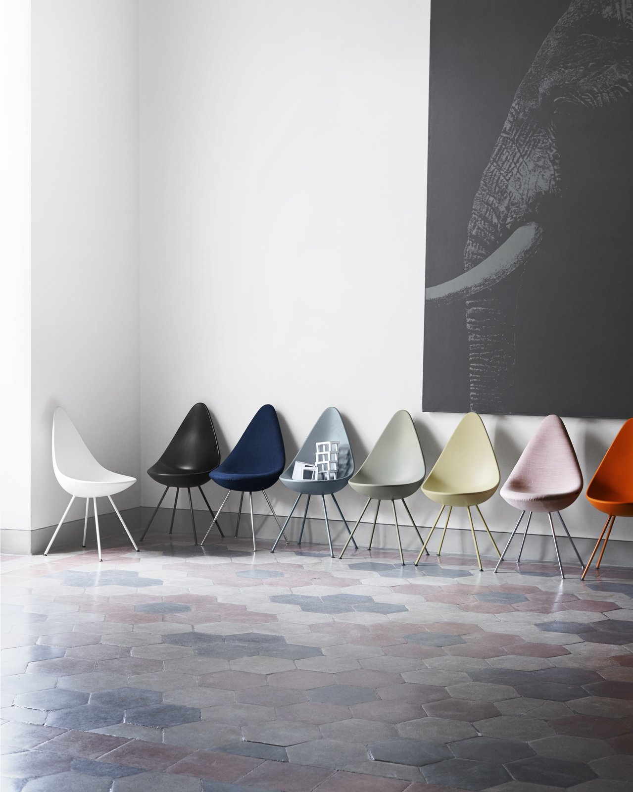 After being out of commission for more than 50 years, the Drop chair is now fully back in production and available in a wide range of color and upholstery options—a number of the various choices are shown here.  Photo 10 of 10 in Jaime Hayon is Given the Keys to an Iconic Copenhagen Hotel