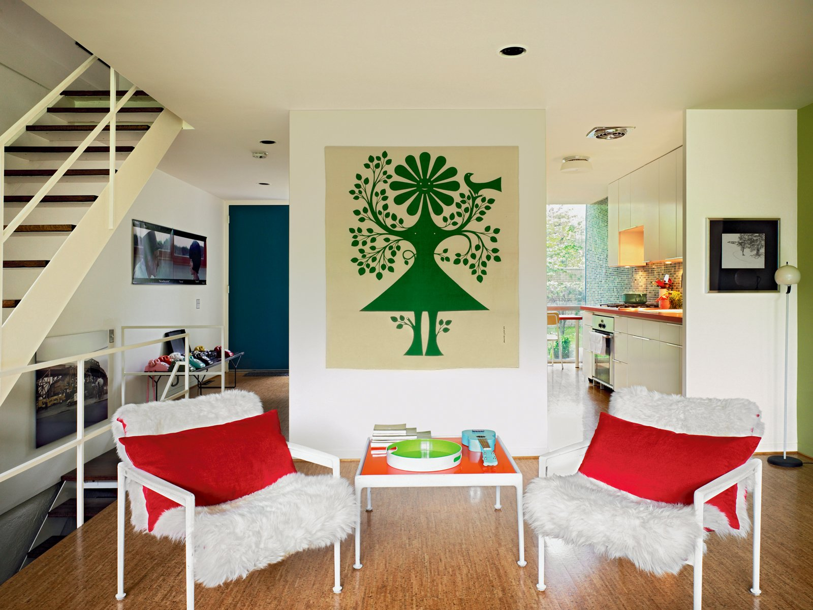 Living Room, Chair, and Medium Hardwood Floor A Richard Schultz outdoor set for Knoll looks at home indoors thanks to some faux fur, and an Alexander Girard Environmental Enrichment panel does its job on the rear wall.  Photo 6 of 10 in What Lies Within America's First Urban-Renewal Project