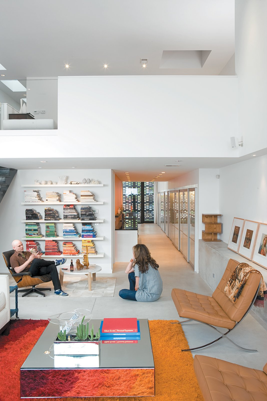 Since Dwell last visited the couple, they now have a daughter and one chair in particular is in constant competition.  Photo 4 of 9 in This is How You Combine Modern Architecture, Flea Market Finds, and Art All Together