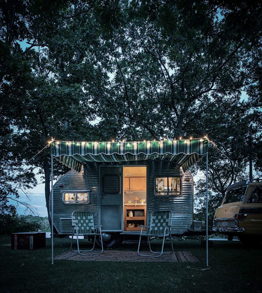 An exterior shot of a trailer at the camp.  Photo 6 of 9 in This is How You Combine Modern Architecture, Flea Market Finds, and Art All Together