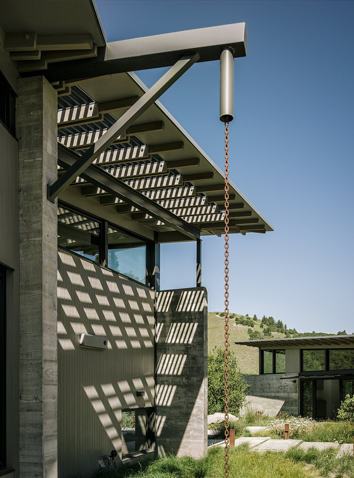 Butterfly House, designed by Feldman Architecture for David and Suzanne Rinaldo in California's Monterey County, is made up of three discrete structures separated by walkways. The distinct folds in the roofs are utilized for rainwater catchment.  Photo 3 of 11 in Retirement Never Looked Better and More Sustainable
