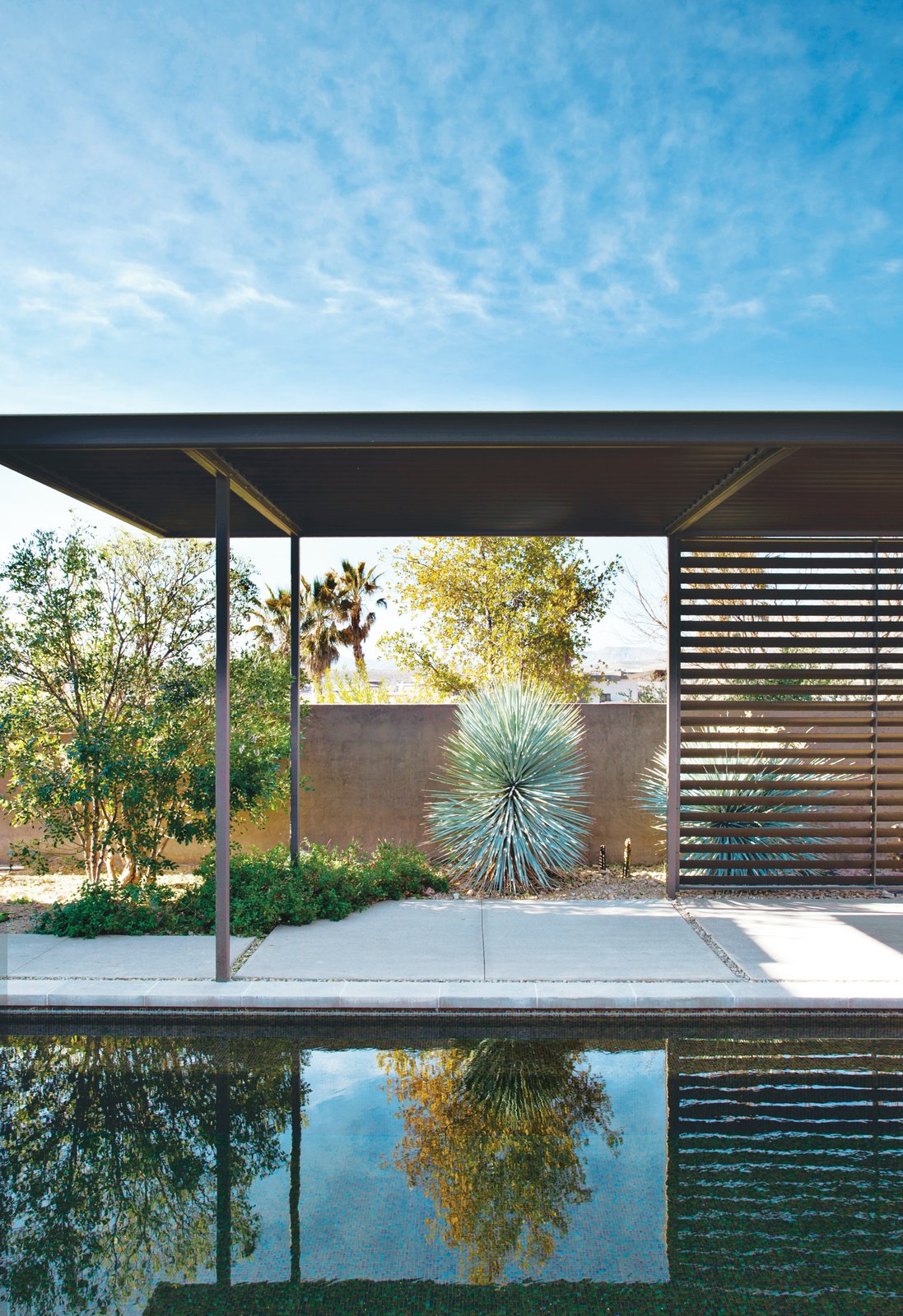 Las Vegas modern desert prefab backyard pool with concrete patio and metal awning accents