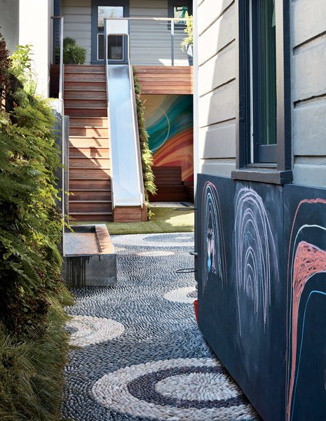 In the Mission District yard Monica Viarengo created for the Sharkey family, outdoor chalkboard paint by Sydney Harbour applied to marine-grade plywood offers a gallery for creativity.  A mural by local artist Erik Otto—inspired by the neighborhood—brightens the back of the space.