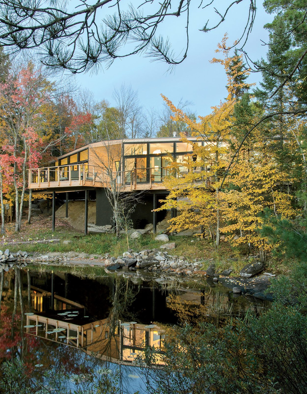 Retirees Dr. Mary Ellen Kennedy and Robert Dault tasked architect Charlie Lazor with bringing a prefabricated 2,100-square-foot home to their lakeside property, located in one of rural Ontario's unorganized territories.  Prefab from This Isolated Prefab Is One with the Wild