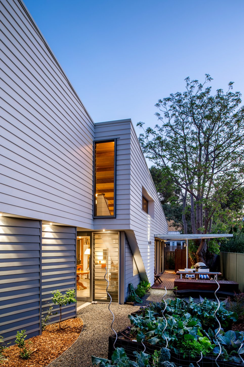 Outdoor, Back Yard, Small Patio, Porch, Deck, Wood Patio, Porch, Deck, and Walkways Native plantings limit the need to use water for irrigation, while a vegetable garden offers a sustainable source of produce.  Photo 4 of 6 in Thin, Mint: A Eco-Friendly House Rises in Compact Quarters