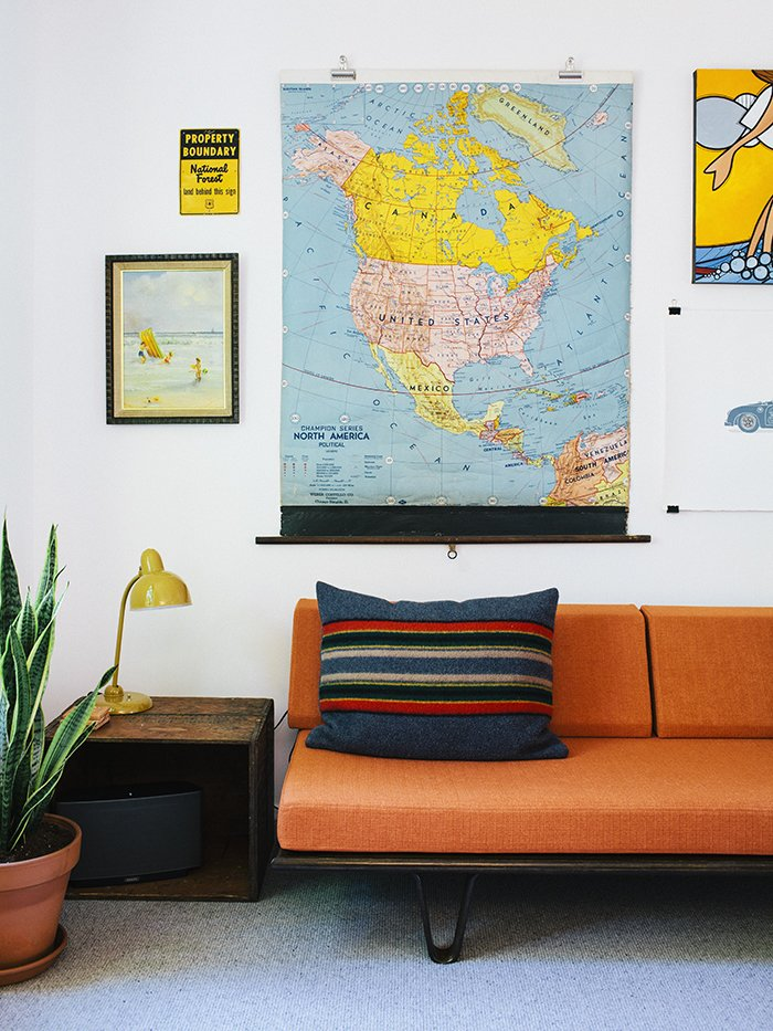 #modern #livingroom #color #map #orangecouch #thematic   Photo By Grant Harder   Tips for Creating a Comfortable Living Room by Drew McGukin from 36+ Interior Color Pop Ideas For Modern Homes