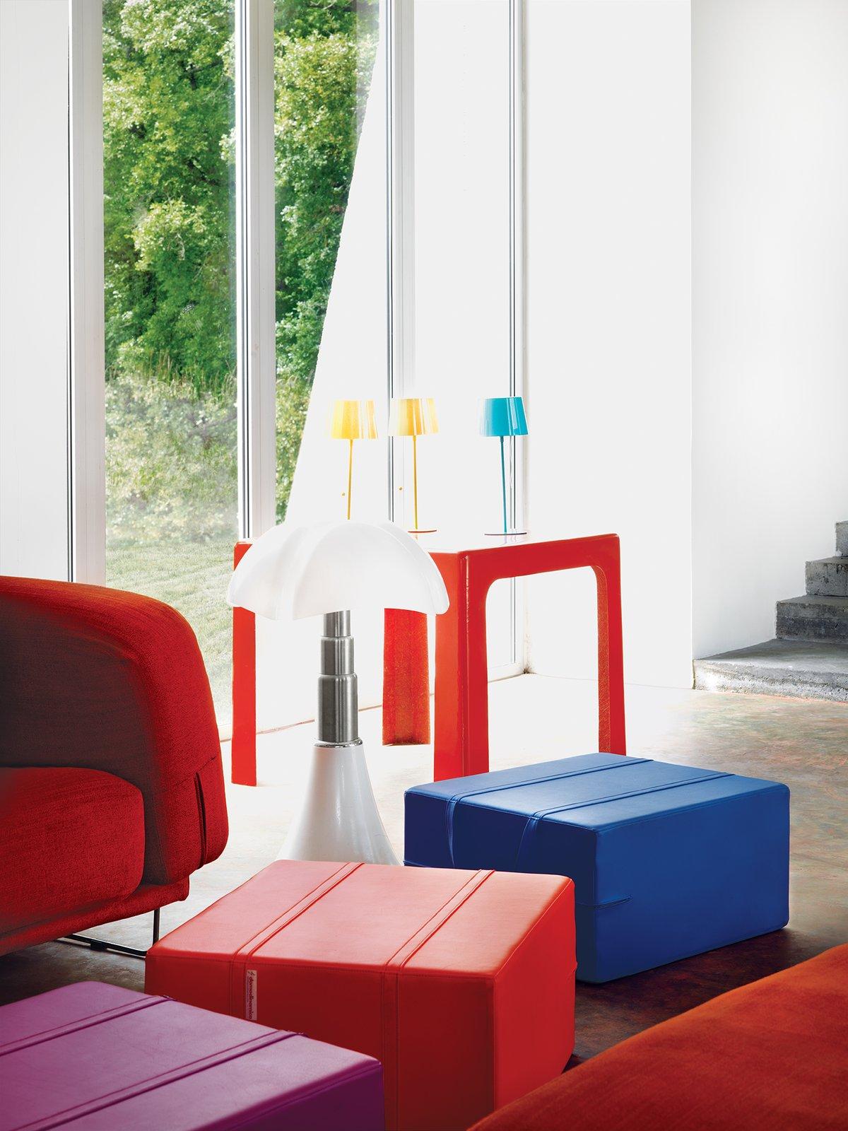 #color #livingroom #ottomans #redchair #floorlamp  Photo by Jonas Ingerstedt   36+ Interior Color Pop Ideas For Modern Homes