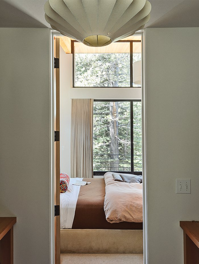 Bedroom, Bed, Pendant Lighting, and Ceiling Lighting Maca inserted a closet-dressing room between the master bedroom and bathroom to offer more privacy to each space. She chose a vintage George Nelson lamp to lend character.  Photo 8 of 11 in The Ski Retreat for All Seasons
