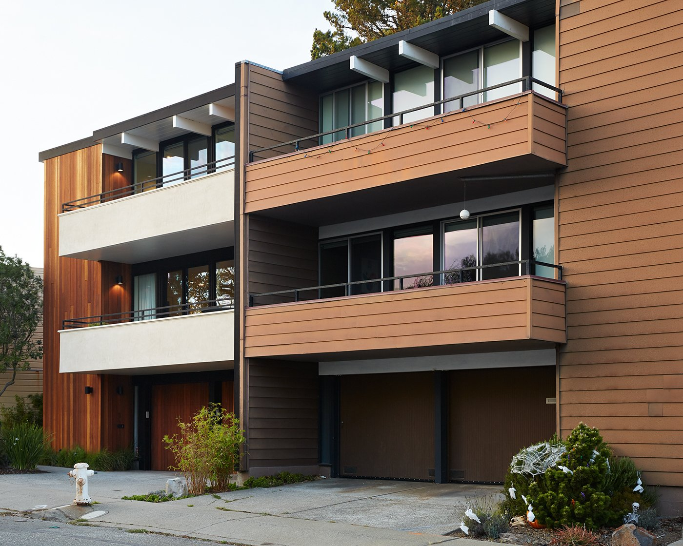 The new house, at left, still complements the neighboring unit, while introducing a clean, modern palette.  Photo 8 of 8 in Not the Eichler Post-and-Beam Style You Know