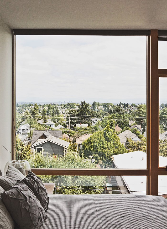 The third-floor master bedroom boasts sweeping views of Seattle.  Photo 5 of 12 in Three Families Comfortably Fit in One Slim Lot