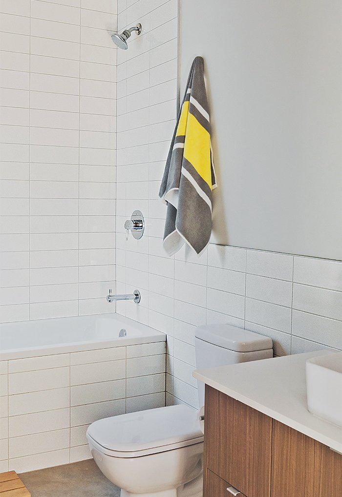 Duravit's D-Code fixtures outfit the bathroom.  Photo 7 of 12 in Three Families Comfortably Fit in One Slim Lot
