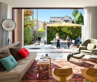 A sliding glass Western Window Systems door dissolves the boundary between indoor and outdoor.