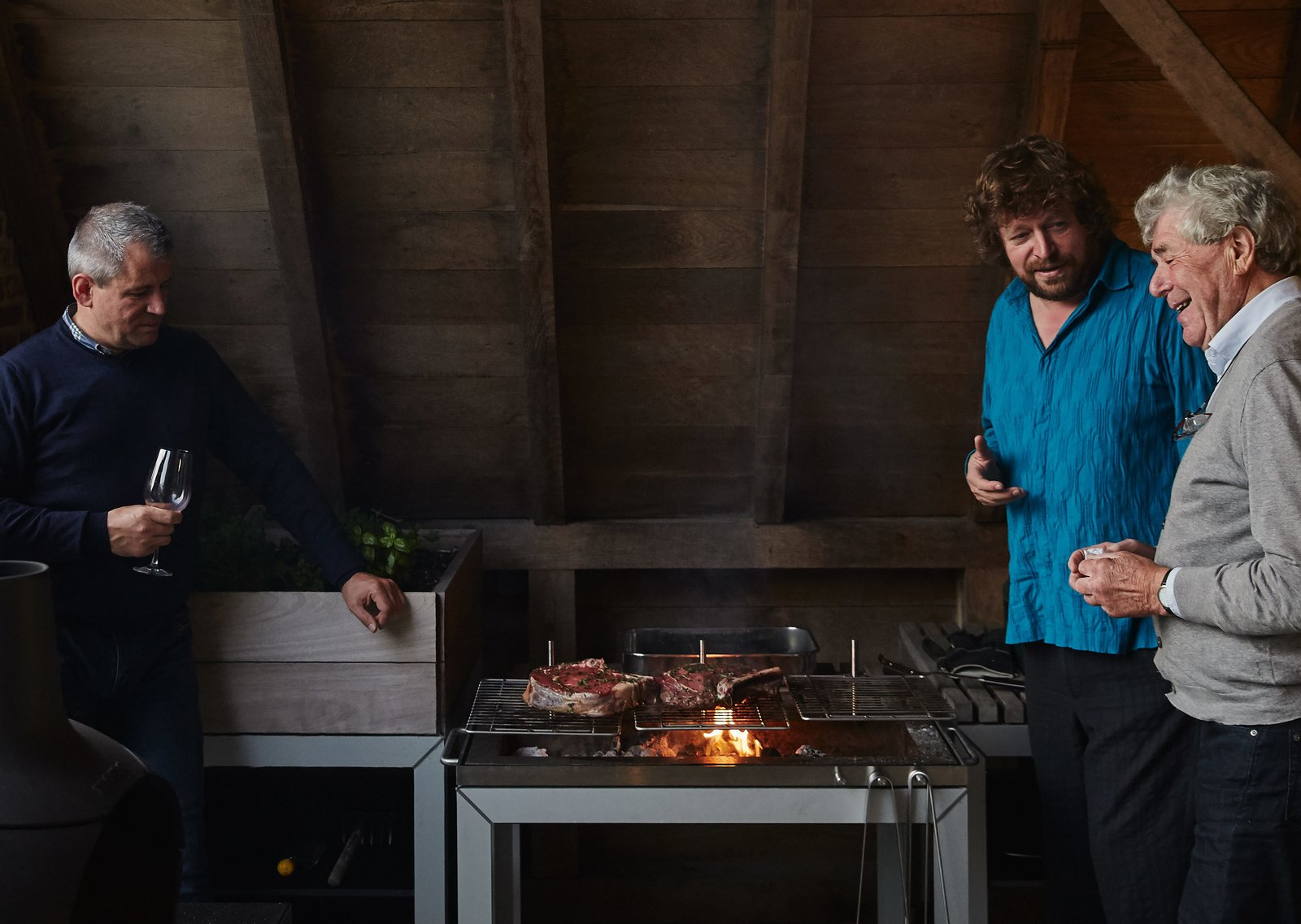 """Kitchen and Range """"It's usable when the weather is not perfect, so we use this area most often,"""" Wynants says.  Photo 8 of 11 in A Kubrick-Esque Farmhouse Kicks Its Fossil Fuel Habit"""