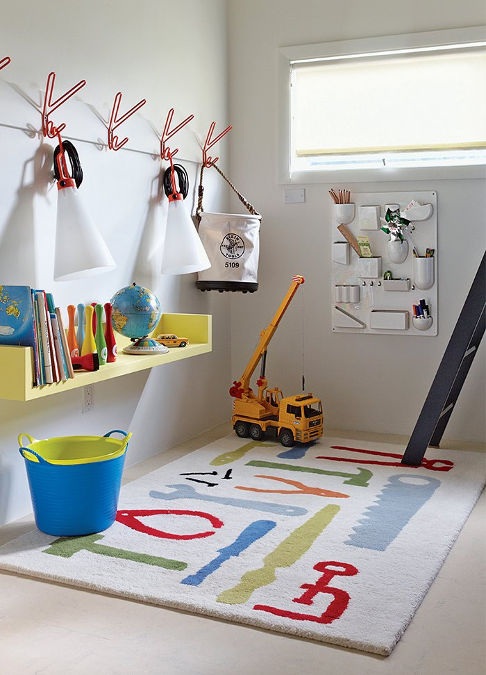 he boys' playroom is outfitted with a Uten.Silo wall organizer by Dorothee Becker for Vitra and a pair of May Day lamps by Konstantin Grcic for Flos that dangle from a set of Peace hooks by Louise Hederström for Maze.  Photo 7 of 9 in How a Smart Interior Design Saved This House