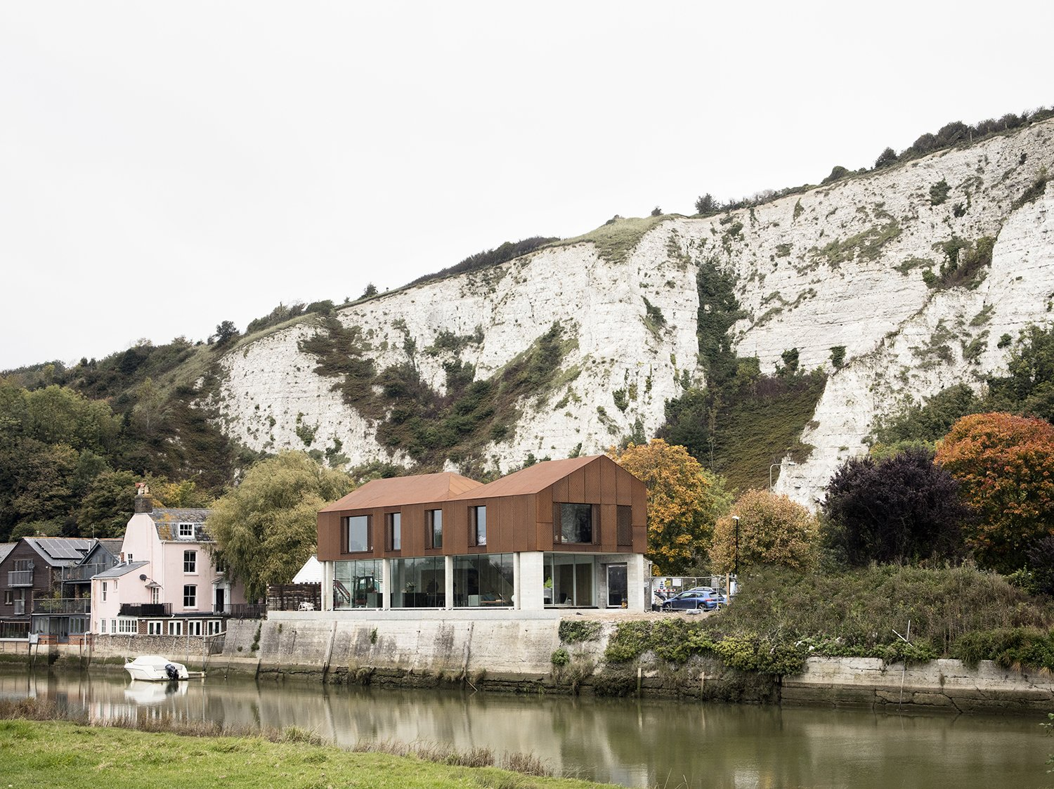 Sandy Rendel Architects replaced an old workshop with a striking new home in Lewes, East Sussex, England. The structure is located right at the edge of the town, in a spot that formerly functioned as a wharf to an adjacent quarry. Due to its prominent siting, the planning authority wanted to see a bold design that would signal the town's entrance. The building shell, made of SIPS, was prefabricated offsite, allowing for significant time savings in construction.  Photo 2 of 7 in Bold House Doubles as a British Town's Welcome Sign