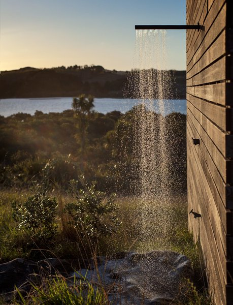 "Just like the interior, the outdoor shower is an exercise in reduction and contrast: It's merely a boulder placed under a showerhead on the side of the building. ""If you really strain your eyes, you can see perhaps one other house,"" Cheshire says of the vista."