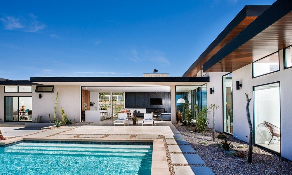 This modern residence by designer Soheil Nakhshab incorporates elements of the surrounding landscape through touches of stone, wood, and iron.  Photo 5 of 6 in A Look Back at Our San Diego Home Tour