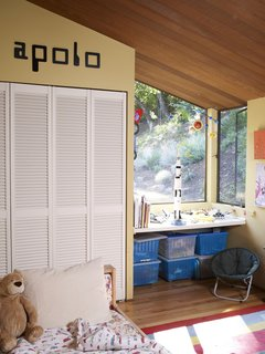 Apolo's bedroom is unmistakably that of a young boy, as the old-school computer font and clear debt to NASA suggest.