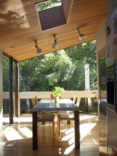 The family is never far from the outdoors, as this lush view from the dining room attests.