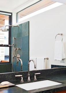 Even the bathroom features narrow ocean views.